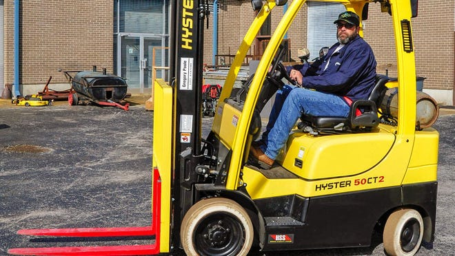 Pamlico Community College Instructor Joe Flynn drives the college's propane-powered forklift behind the Johnson Building in this file photo. PCC will be offering a one-day, face-to-face Forklift Training course on June 27 and again on July 11 and July 25.