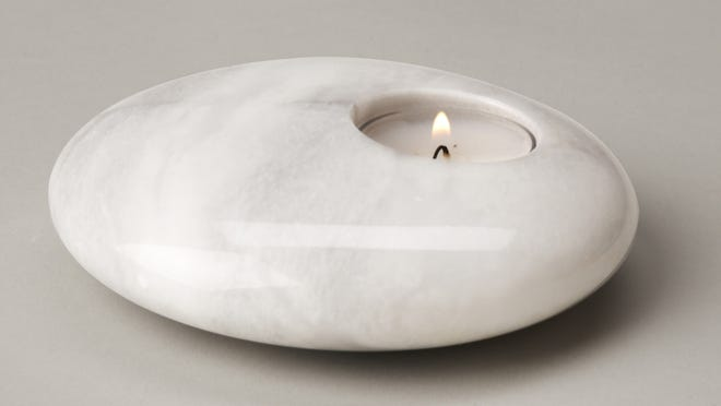 Au natural material shines in your home. Marble sheen chandleholder, $8 at thenthousandvillages.com.