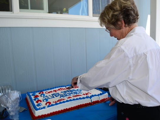 Silver Springs Airport owner Kay Bennett cuts a cake