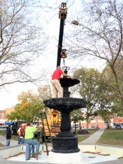 A memorial fountain to late Mount Pleasant Mayor Edd King was dismantled downtown on Wednesday, Oct. 21, 2015. The fountain will be refurbished over the winter in Alabama.