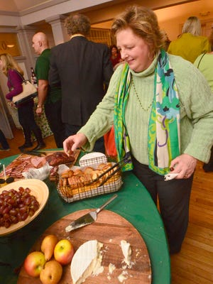 Emma Justice of Cedar Grove, a former Montclair Ambulance Unit board member, circulates through the room at last year's St. Patrick's Day bash in the Commonwealth Club.