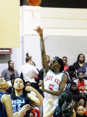 North Caddo's Jadah Martin is rising above the crowd in leading the Lady Rebels in the LHSAA Class 2A state playoffs.