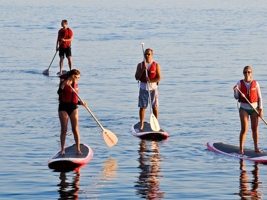 Paddleboarders enjoy Burlington harbor on Lake Champlain.