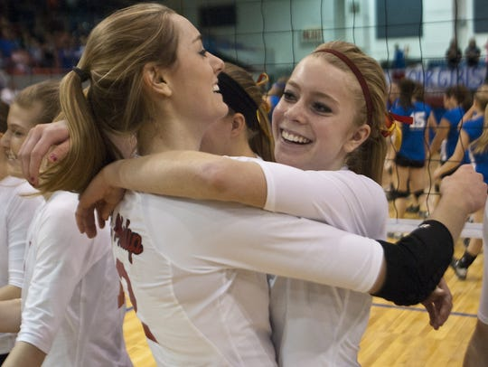 St. Philip's Abby McKinzie, right, hugs her older sister,