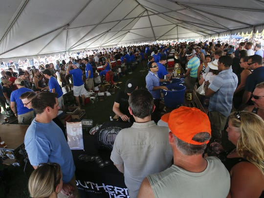 The main tent is overflowing with beer enthusiasts at the 2015 America On Tap Craft Beer Festival at Wilmington's Tubman-Garrett Riverfront Park.