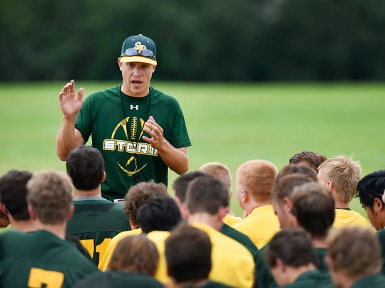 Sauk Rapids new head coach Phillip Klaphake talks with players at the end of the first day of practice Monday, Aug. 15, 2016, in Sauk Rapids.