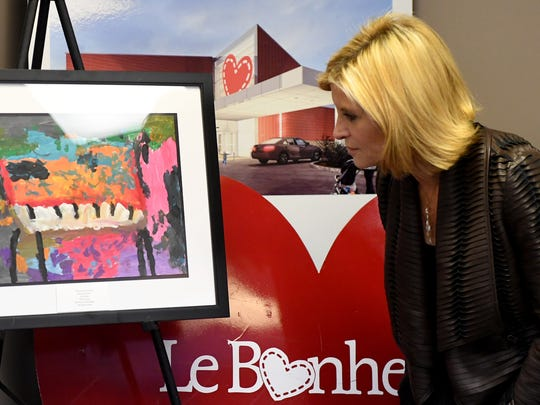 Linda Hill, Art Development Director for Le Bonheur Children's Hospital looks at this year's winning Color of Music Contest painting. The Jackson Symphony League and Le Bonheur Children's Hospital announced their partnership, Tuesday, October 17.
