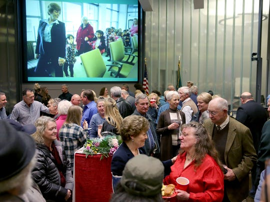 Bremerton Mayor Patty Lent has a big crowd of well wishers at her retirement party at the Norm Dicks Government Center on Thursday.