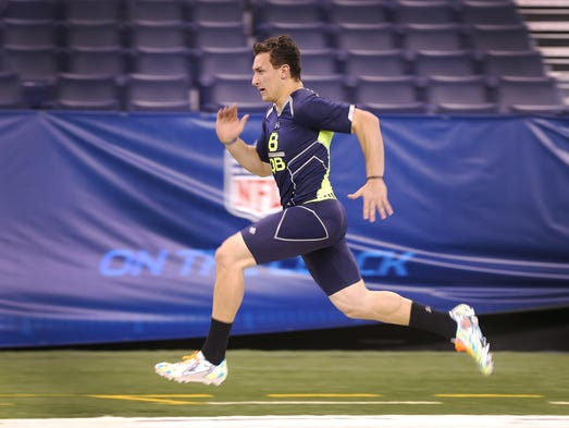 Texas A&M quarterback Johnny Manziel runs his 40-yard-dash during the second day of the NFL Scouting Combine Sunday at Lucas Oil Stadium.