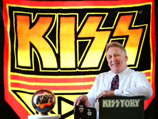 "While original Kiss Army commander-in-chief Bill Starkey doesn't classify himself as a Kiss collector, he hangs onto items that have a personal connection. This photo includes a Kiss Army blanket as a backdrop, a Kiss bowling ball he received as a gift from Kiss Army Warehouse co-owner Steve Stierwalt and two items of memorabilia that mention Starkey's role in the founding of the Kiss Army: a Kiss Trivia Game and the 1995 coffee-table book ""Kisstory."""