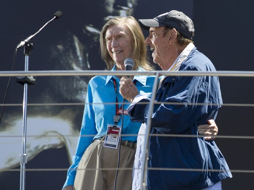 Mari Hulman George and Jim Nabors embrace as they give