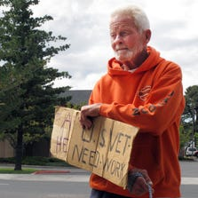 Richard Russler, 77, stands on a corner in Flagstaff  asking passers-by for financial help.