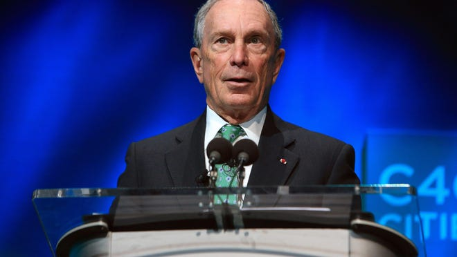 Former New York Mayor Michael Bloomberg speaks during the C40 cities awards ceremony, in Paris. Bloomberg is taking some early steps toward launching a potential independent campaign for president. That's according to three people familiar with the billionaire media executive's plans.