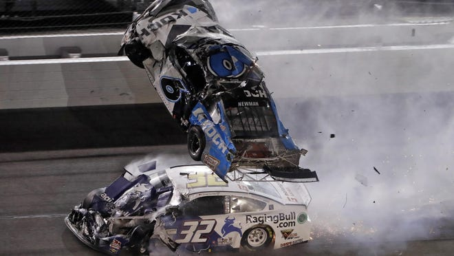 Ryan Newman goes airborne after crashing with Corey LaJoie (32) during the Daytona 500 on Feb. 1, at Daytona International Speedway in Daytona Beach, Fla.