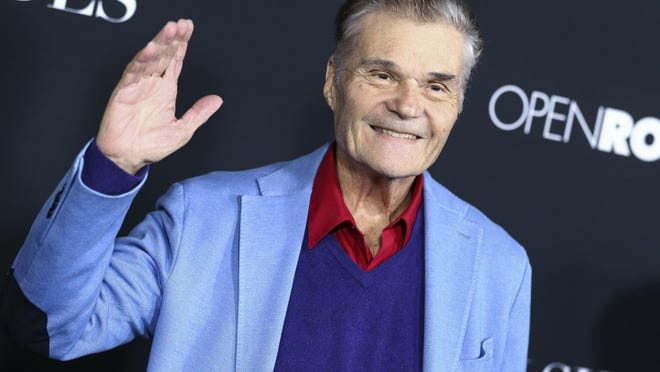 """FILE - In this Jan. 26, 2016, file photo, Fred Willard attends the LA Premiere of """"50 Shades of Black"""" held at Regal L.A. Live, in Los Angeles. Willard, the comedic actor whose improv style kept him relevant for more than 50 years in films like """"This Is Spinal Tap,"""" """"Best In Show"""" and """"Anchorman,"""" has died at age 86. Willard's daughter, Hope Mulbarger, said in a statement Saturday, May 16, 2020, that her father died peacefully Friday night."""