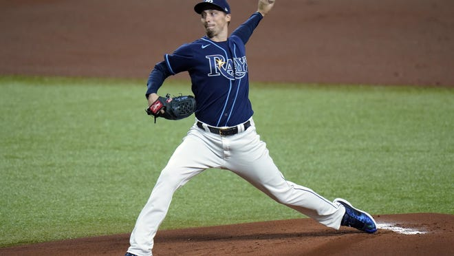 Rays starter Blake Snell delivers a pitch to a Red Sox batter during the first inning of Friday night's game in St. Petersburg, Fla. Tampa Bay started a lineup of all pure left-handers, the first time that has ever happened since 1901.