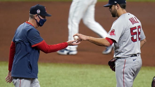 Matt Hall took the loss for the Red Sox on Friday after Ron Roenicke came for the ball.