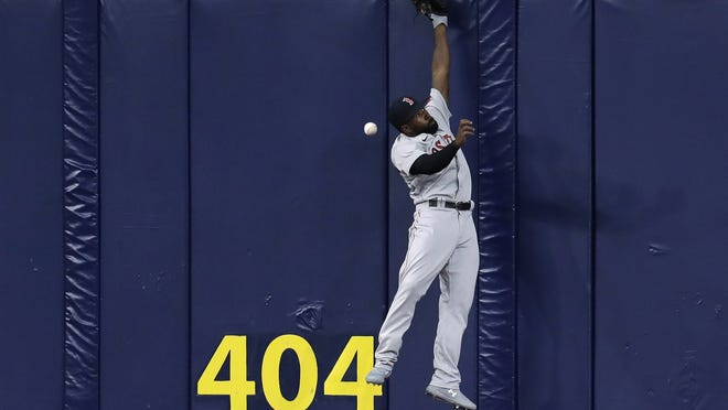 Boston Red Sox center fielder Jackie Bradley Jr. (19) can't make the catch on a triple by Tampa Bay Rays' Joey Wendle during the second inning of Tuesday's game in St. Petersburg, Fla.