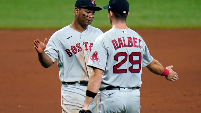 Red Sox third baseman Rafael Devers, left, and first baseman Bobby Dalbec celebrate after the team defeated the Rays on Thursday night.