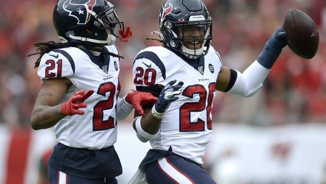 Houston Texans strong safety Justin Reid (20) celebrates with cornerback Bradley Roby (21) after Reid intercepted a pass by Tampa Bay Buccaneers quarterback Jameis Winston during an NFL football game in 2019 (AP Photo/Jason Behnken).