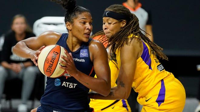Connecticut Sun forward Alyssa Thomas (25) drives against Los Angeles Sparks guard Seimone Augustus (33) during the second half of a WNBA playoff basketball game Thursday, Sept. 17, 2020, in Bradenton, Fla.
