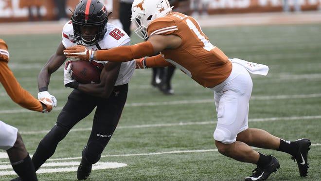 Texas defensive back Brandon Jones, right, closes in on Texas Tech receiver KeSean Carter (82) during last year's regular-season finale in Austin. The same two teams meet again in a Big 12 opener Saturday at Jones AT&T Stadium.