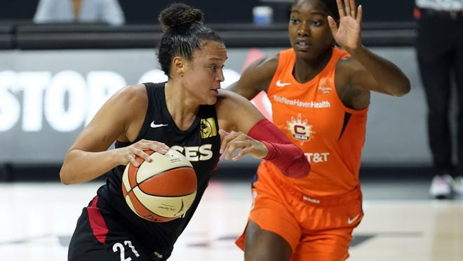 Las Vegas Aces guard Kayla McBride (21) drives against Connecticut Sun guard Kaila Charles (3) during Game 2 of a WNBA semifinal playoff series Tuesday, Sept. 22, 2020, in Bradenton, Fla.