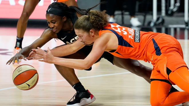 Las Vegas Aces guard Jackie Young (0) and Connecticut Sun forward Theresa Plaisance (55) chase a loose ball during the second half of Game 2 of a WNBA basketball semifinal round playoff game Tuesday, Sept. 22, 2020, in Bradenton, Fla.