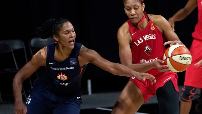 Connecticut Sun forward Alyssa Thomas (25) knocks the ball away from Las Vegas Aces center A'ja Wilson (22) during the second half of Game 3 of a WNBA basketball semifinal round playoff series Thursday, Sept. 24, 2020, in Bradenton, Fla.