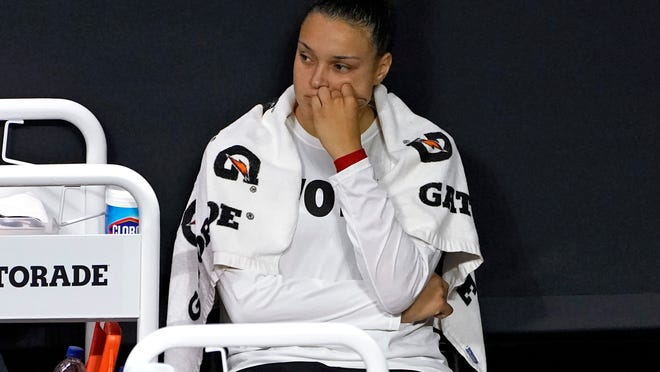 Las Vegas Aces guard Kayla McBride reacts on the bench after the team lost to the Seattle Storm during Game 3 of basketball's WNBA Finals Tuesday, Oct. 6, 2020, in Bradenton, Fla. (AP Photo/Chris O'Meara)