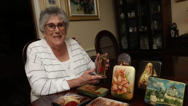 Marian Pruslin, of Wellesley, with some of her Russian boxes. She has donated several to the Museum of Russian Icons in Clinton.