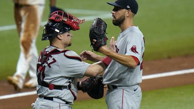 Boston Red Sox catcher Christian Vazquez, left, and pitcher Matt Barnes celebrate after closing out the Tampa Bay Rays in the ninth inning Thursday, Sept. 10, in St. Petersburg, Fla.