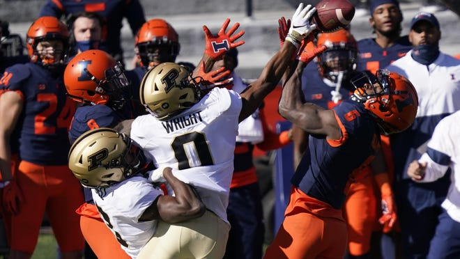 Purdue wide receiver Milton Wright (0) keeps Illinois defensive back Tony Adams (6) from intercepting a pass Saturday, Oct. 31 in Champaign, Ill.