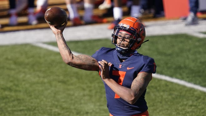Illinois quarterback Coran Taylor passes during the first half of an NCAA college football game against Purdue on Saturday, Oct. 31, 2020, in Champaign, Ill.