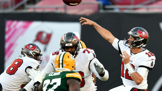 Tampa Bay Buccaneers quarterback Tom Brady (12) throws a pass against the Green Bay Packers during the second half Sunday in Tampa, Fla.