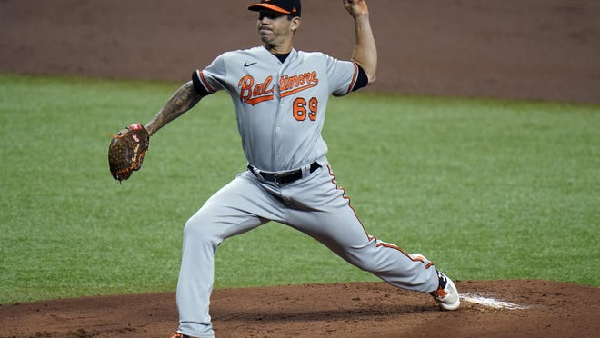Baltimore starting pitcher Tommy Milone was traded to the Braves and was to start Sunday night's game at Philadelphia. He is 1-4 with a 3.99 ERA over six starts in his first season with the Orioles.