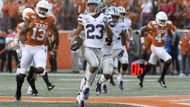 Kansas State's Joshua Youngblood (23), seen returning a kick for a touchdown last season at Texas, missed valuable time working at wide receiver when spring practice was canceled because of the coronavirus pandemic.