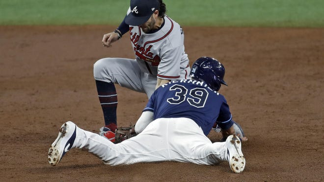 Tampa Bay Rays' Kevin Kiermaier (39) steals second base as Atlanta Braves shortstop Dansby Swanson is late with the tag during the third inning of a baseball game Tuesday, July 28, 2020, in St. Petersburg, Fla.