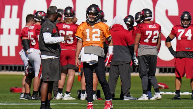 Tampa Bay Buccaneers quarterback Tom Brady (12) talks to offensive coordinator Byron Leftwich during an NFL football practice Wednesday, Jan. 6, 2021, in Tampa, Fla. The Buccaneers play the Washington Football Team in a playoff game Saturday night. (AP Photo/Chris O'Meara)