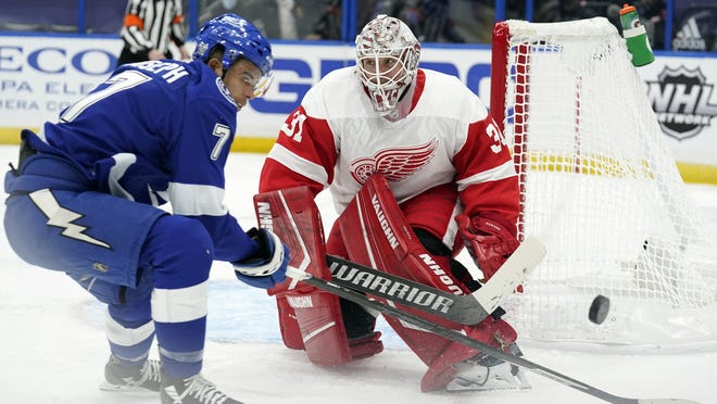 Detroit Red Wings goaltender Calvin Pickard (31) makes a save on a shot by Tampa Bay Lightning right wing Mathieu Joseph (7) during the second period of an NHL hockey game Wednesday, Feb. 3, 2021, in Tampa, Fla.