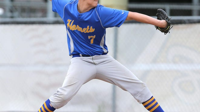 East Canton's Austin Hamilton delivers a pitch during the first inning of a Division IV district semifinal against Hillsdale at Medina on May 21, 2019. Hillsdale won 1-0.
