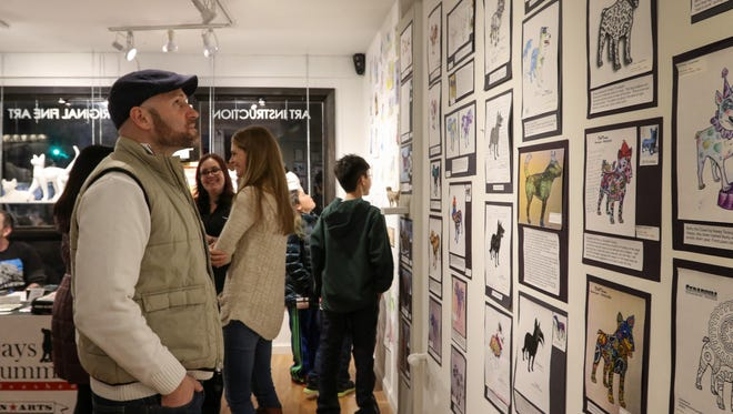Boonton Mayor Matthew Di Lauri looks at the artwork during the reception at Speakeasy Art Gallery to unveil  artist submissions for the 2017 Dog Days of Summer in Boonton on February 22, 2017.