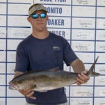 Kevin Robertson, 35, of Gulf Breeze with an Amberjack.