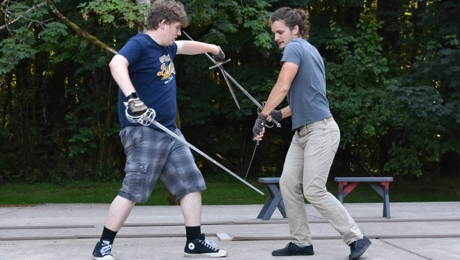 """Romeo (Spence Logan) sword fights with Tybalt (Justin Wanner) in a rehearsal for Keizer Homegrown Theater's July 19-22 production of """"Romeo and Juliet"""" at the Keizer Rotary Amphitheatre."""