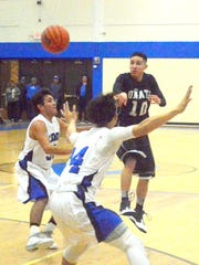 Knights junior point guard Tony Zamora passes the ball into the post in the second quarter Saturday at Carlsbad.