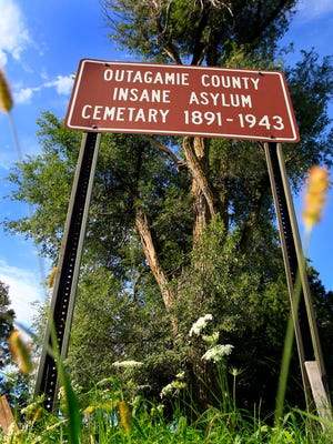 A sign marks the former Outagamie County Insane Asylum Cemetery in Grand Chute.