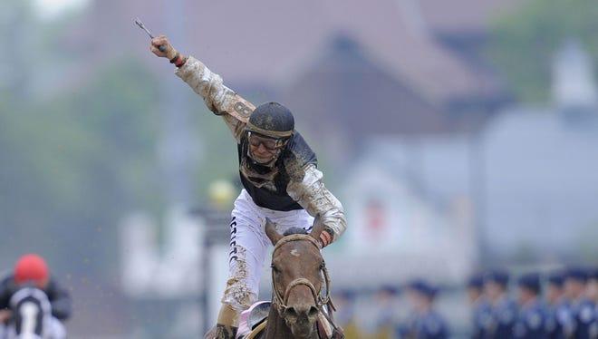 Jockey Calvin Borel celebrates after winning the KY Derby aboard longhsot Mine Taht Bird.  (BY Pat McDonogh, The Courier-Journal, May 2, 2009)