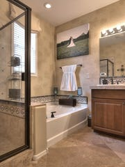The master bathroom of the mid-priced Gilbert home