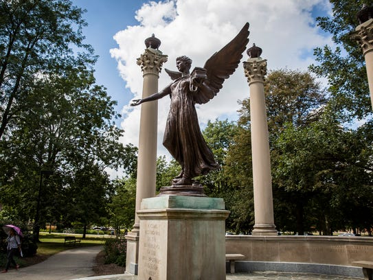 Students walk past Beneficence on Ball State's campus.