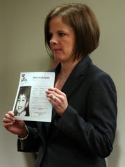 Opening statements were heard in the Michelle Lodzinski murder trial in the courtroom of Judge Dennis Nieves, Middlesex County Superior Court in New Brunswick on Wednesday March 16, 2016. Here, Middlesex County Assistant Prosecutor Christie Bevacqua shows the jury a missing person poster of Wiltsey.